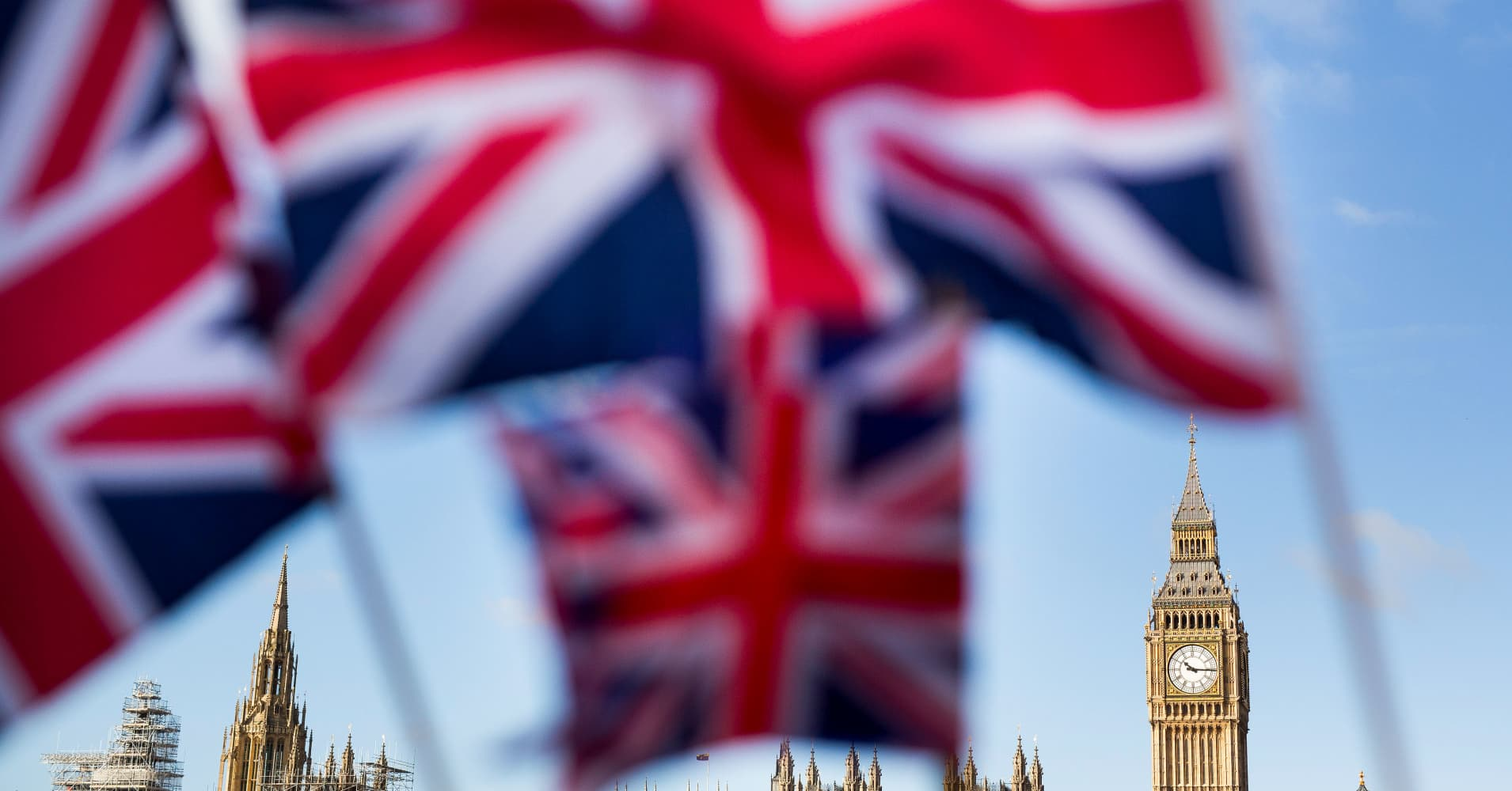 A display of U.K., Union Jack flags fly in front of The Houses of Parliament, in London, U.K., on Monday, Feb. 15, 2016.