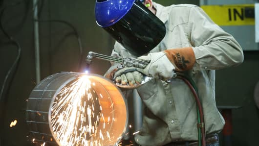 An employee welds pipe at Pioneer Pipe on October 25, 2016 in Marietta, Ohio.