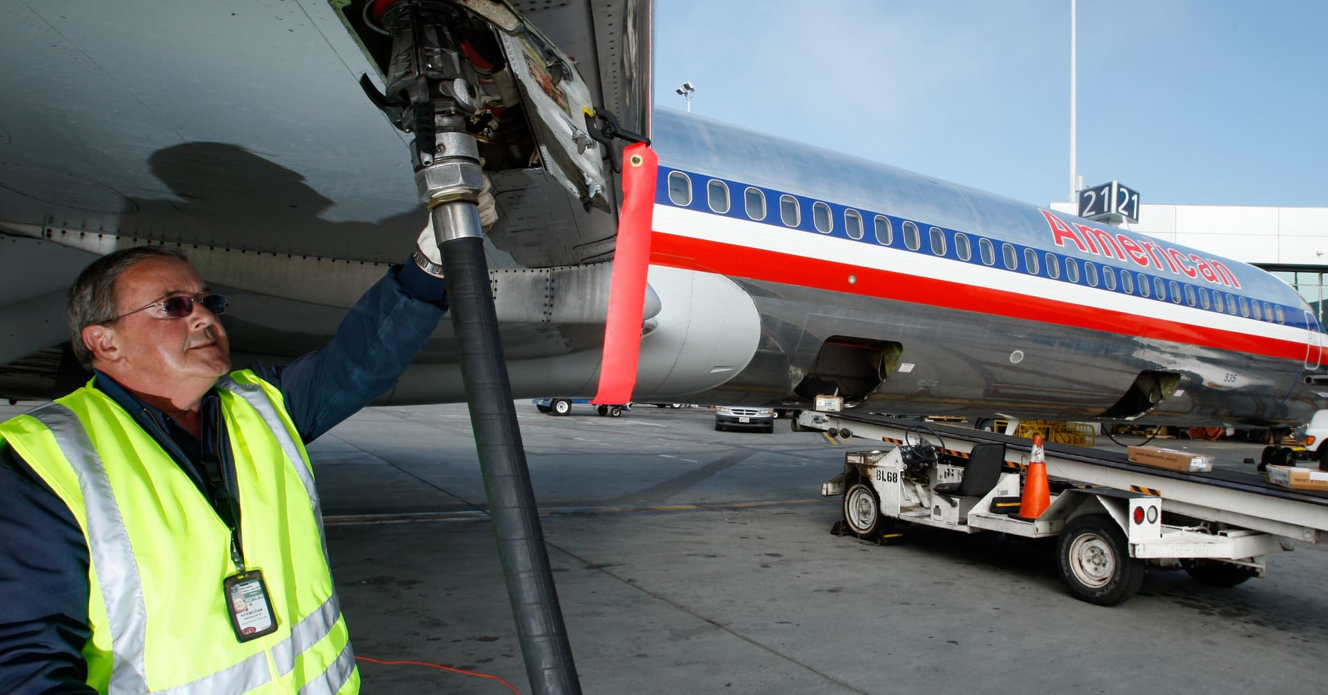A worker fuels an airliner in Oakland, Calif.
