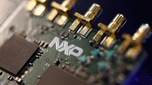 Microprocessors on a circuit board displayed at the Mobile World Congress in Barcelona, Spain, March 2, 2015.