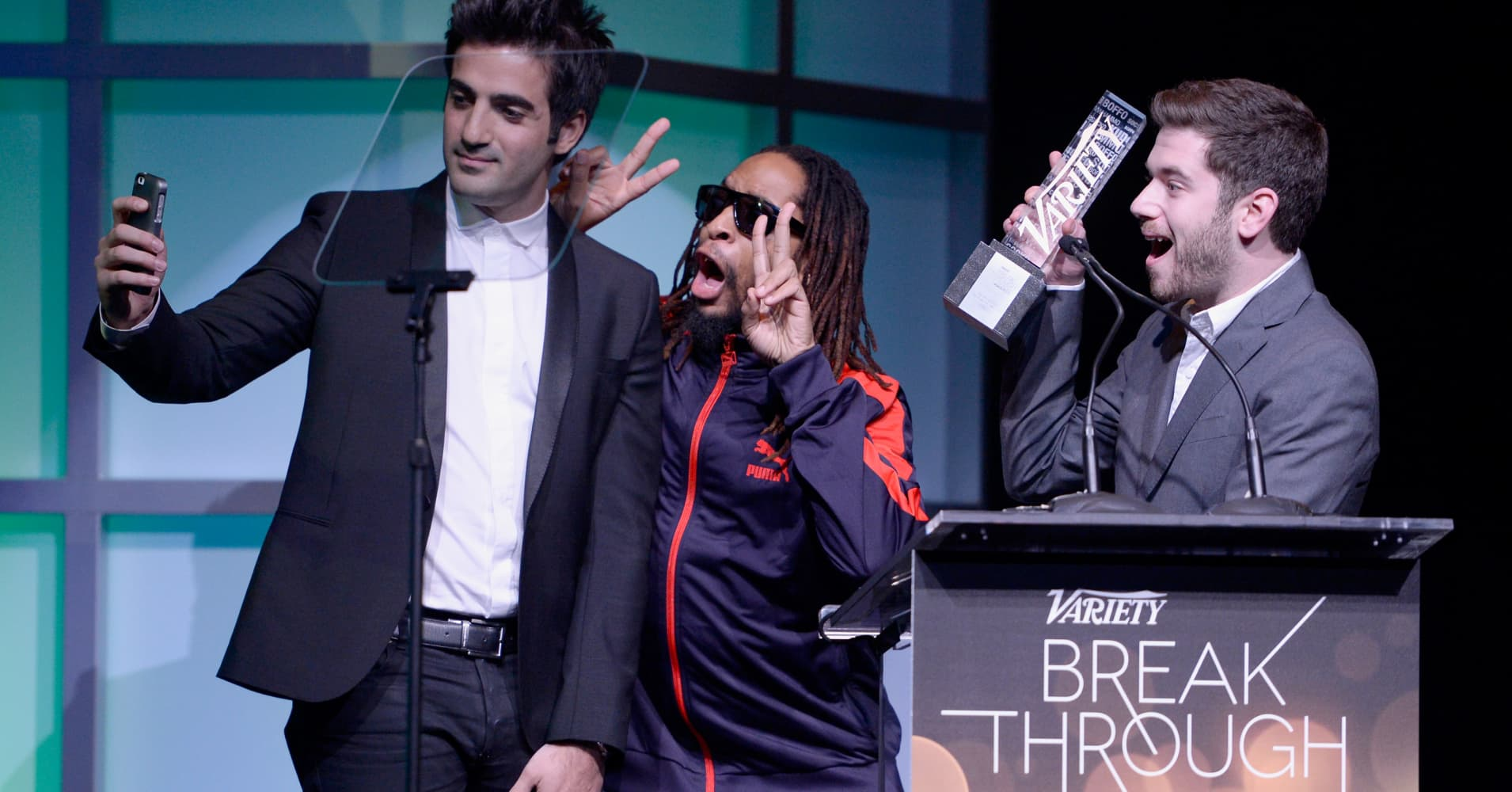 Honorees Rus Yusupov (L) and Colin Kroll (R) accept the Breakthrough Award for Emerging Technology from rapper Lil Jon (C) onstage at the Variety Breakthrough of the Year Awards during the 2014 International CES at The Las Vegas Hotel & Casino on January 9, 2014 in Las Vegas, Nevada.