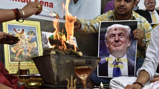 Hindu Sena activists organize a hawan and chant mantras invoking the Hindu Gods to help Republican candidate Donald Trump to win the US presidential election at Jantar Mantar on May 11, 2016 in New Delhi, India.
