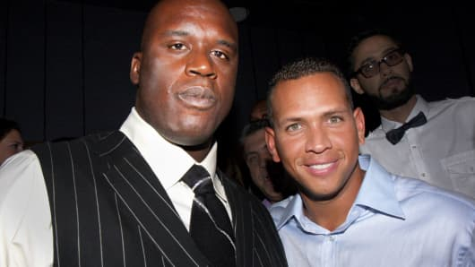 Former pro athletes Shaquille O'Neal (left) and Alex Rodriguez purchased equity in NRG eSports.