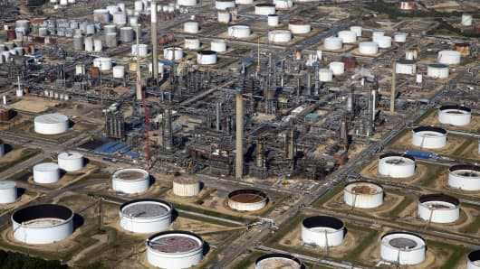 Oil storage tanks and refining facilities sit at a refinery operated by Exxon Mobil Corp.