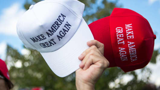 A vendor sells hats to supporters before a campaign rally for Republican presidential nominee Donald Trump on October 21, 2016 in Newtown, Pennsylvania.