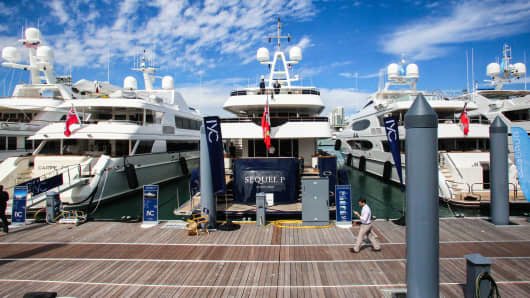 Superyachts sit moored during the Superyacht Miami boat show at Island Gardens Deep Harbour in Biscayne Bay, Miami, Florida.