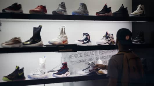 A customer browses Nike sneakers for sale inside a Foot Locker store on the Third Street Promenade in Santa Monica, California.