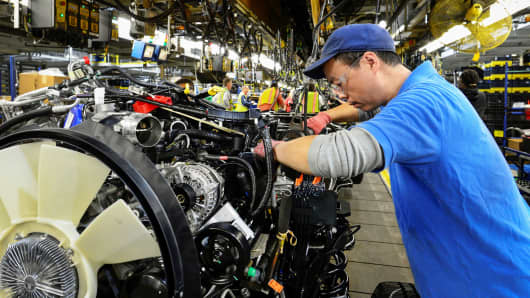 John Bi assembles a Ford truck at the new Louisville Ford truck plant in Louisville, Kentucky.
