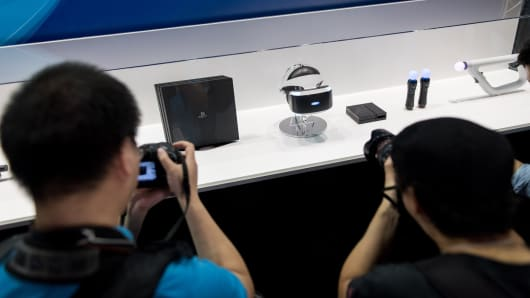 Visitors take pictures of the new Playstation 4 Pro and the Sony VR.
