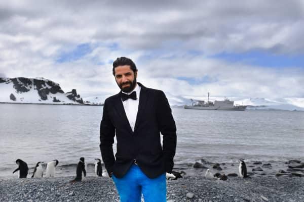 "Jon Levy in Antarctica, ""in a penguin suit hanging with penguins."""