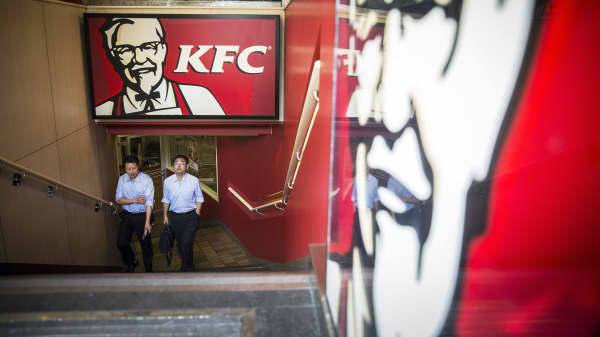 Customers leave a Yum! Brands Inc. KFC restaurant in Shanghai, China.