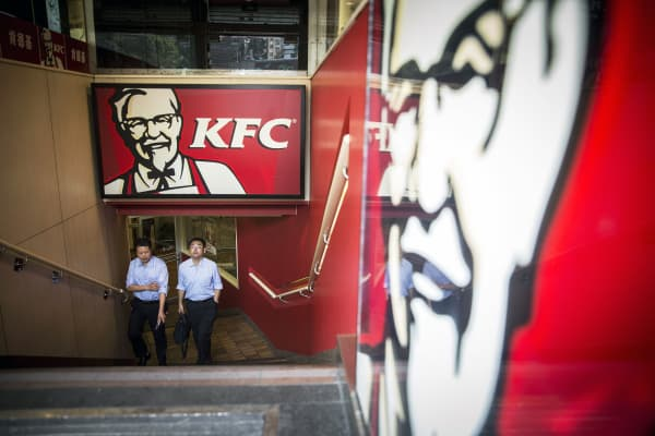 Customers leave a Yum! Brands Inc. KFC restaurant in Shanghai, China.