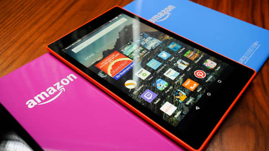 Amazon Fire HD 8 tablet computers in a variety of colors are displayed for a photograph in San Francisco, California, U.S., on Wednesday, Sept. 16, 2015.