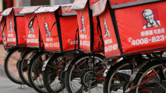 Logos of KFC, owned by Yum Brands Inc, are seen on its delivery bicycles in front of its restaurant in Beijing.
