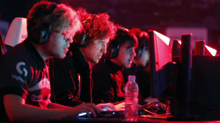 E-Sports players compete a video game 'League of Legends' developed by Riot Games during an electronic video game tournament at the 'Paris Games Week' on October 28, 2016 in Paris, France.