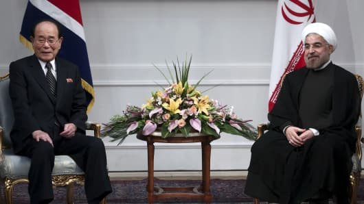 Iranian President Hasan Rouhani, right, meets with a top North Korean leader, Kim Yong Nam, in Tehran, Iran, Saturday, Aug. 3, 2013.