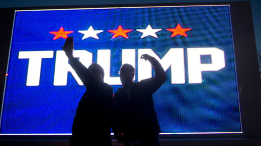 Donald Trump supporters take a selfie in front of an electronic billboard truck in Summerlin, Nev.