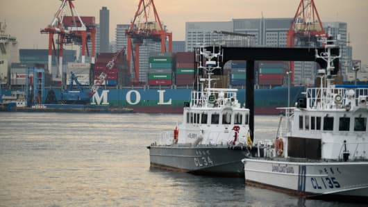 A Mitsui OSK Lines (MOL) container ship at a shipping terminal in Tokyo on Oct. 31, 2016. Japan's three biggest shippers agreed to spin off their container operations and merge them to create the world's sixth-largest box carrier as the global container-shipping industry continues to shrink.