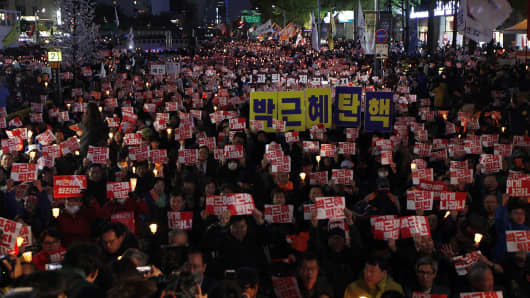 housands of South Koreans took to the streets in the city center to demand President Park Geun-hye to step down on October 29, 2016 in Seoul, South Korea.
