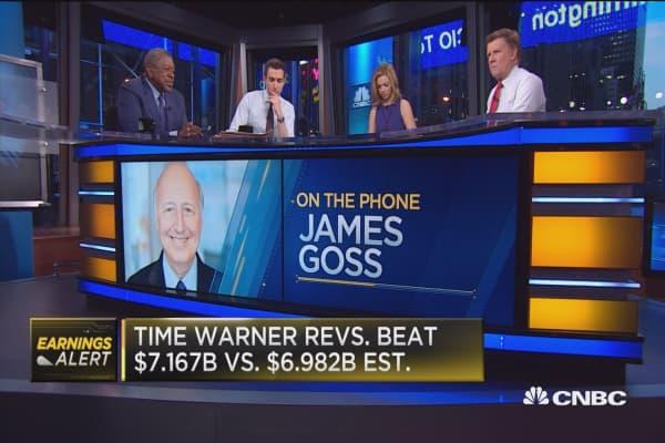 Time Warner beats Street, raises full-year outlook