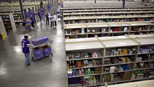 Items sit on shelves as employees work inside the Jet.com Inc. fulfillment center on Cyber Monday in Kansas City, Kansas.