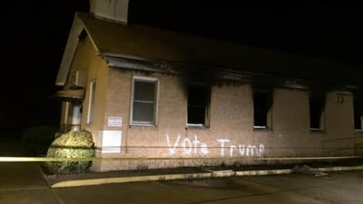 """After a fire consumed the Hope Well Baptist Church, the words """"Vote Trump"""" were written along the side of the building in Greenville, Mississippi."""