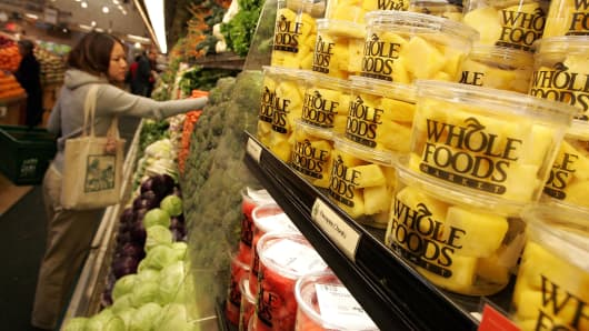 A customer shops for produce at a Whole Foods Market.