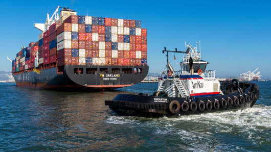 The Yang Ming Marine Transport Corporation Oakland cargo ship is guided into the Port of Oakland by an AmNav tug boat.