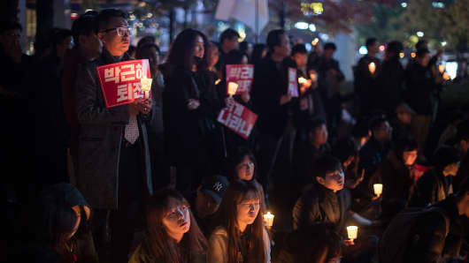 Protestors call for the resignation of South Korea's President Park Geun-hye as a snowballing political scandal continues to unfold.