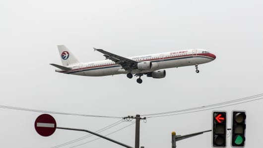 A China Eastern Airlines aircraft approaches to land at Hongqiao Airport in Shanghai.