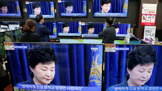 Employees watch TV sets broadcasting a news report on South Korean President Park Geun-hye releasing a statement to the public in Seoul, South Korea.