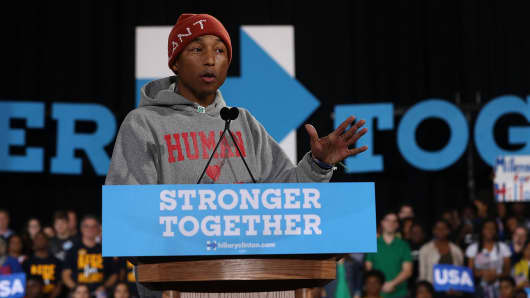Recording artist Pharrell Williams speaks during a campaign rally with Democratic presidential nominee Hillary Clinton.