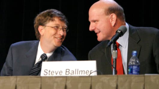 Microsoft Chairman Bill Gates, left, and CEO Steve Ballmer speak to each other at the annual stockholders meeting in Bellevue, Washington, November 9, 2004.