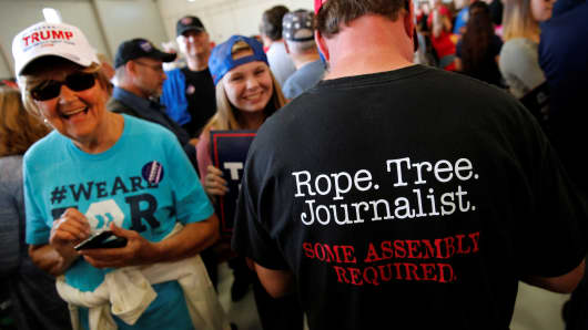 "A man wears a shirt reading ""Rope. Tree. Journalist."" as supporters gather to rally with Republican presidential nominee Donald Trump in a cargo hangar at Minneapolis Saint Paul International Airport in Minneapolis, Minnesota, U.S. November 6, 2016."