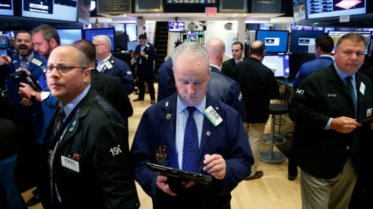 Traders work on the floor of the New York Stock Exchange (NYSE) in New York City, U.S., November 7, 2016.