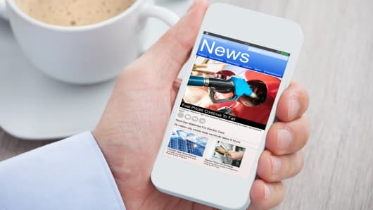 Reading news on a smartphone