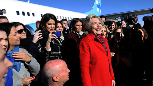 Democratic presidential nominee former Secretary of State Hillary Clinton prepares to take a picture with members of her traveling press before boarding her campaign plane at Westchester County Airport on Nov. 7, 2016 in White Plains, N.Y.