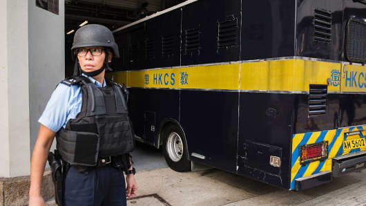 A prison van carrying British banker Rurik Jutting arrives at the High Court in Hong Kong on November 7, 2016.
