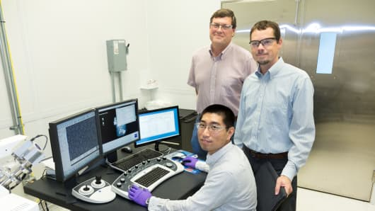 ORNL's Yang Song (seated), Dale Hensley (standing left) and Adam Rondinone