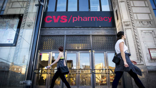 Pedestrians walk past a CVS Health Corp. store in Chicago, Illinois, U.S., on Sunday, Nov. 6, 2016.