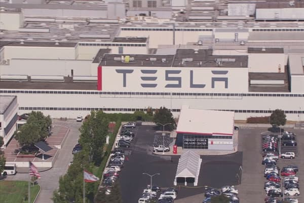 Tesla buys German engineering firm to ramp up production