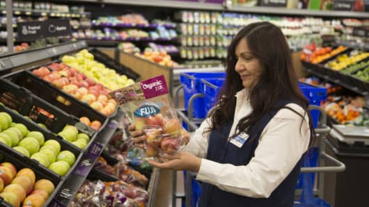 Employee fills online grocery order at Wal-Mart store