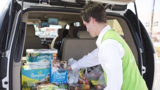 Customer makes online grocery pickup at Wal-Mart
