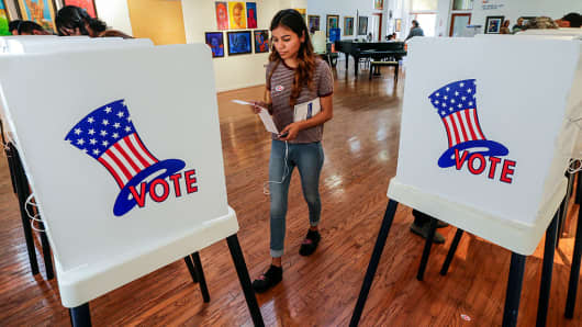 A first time voter, walks up to polling booth to cast her vote at a polling station set-up at Watts Towers Arts Center on November 8, 2016 in Los Angeles, California.