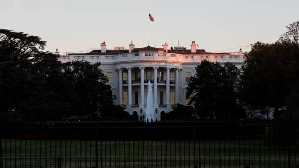 The sun rises near the White House on November 8, 2016 in Washington, DC. Americans today will choose between Republican presidential candidate Donald Trump and Democratic presidential candidate Hillary Clinton as they go to the polls to vote for the next president of the United States.