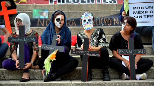 Women take part in a demonstration against the TPP in Mexico City, on November 4, 2016.