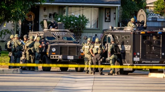 SWAT team moves in on a barricaded suspect on Fourth Street east of Orange Avenue after several people were shot at that location in Azusa, Calif., Tuesday, Nov. 8, 2016.