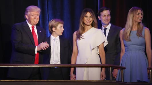 Republican U.S. president-elect Donald Trump stands with his son Barron (C), wife Melania, son-in-law Jared Kushner and daughter Ivanka Trump at his election night rally in Manhattan, New York, U.S., November 9, 2016.