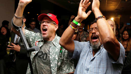 William Britt (L) and Al Moreno (R) celebrate after Californians voted to pass Prop 64, legalizing recreational use of marijuana in the state, in Los Angeles, November 8, 2016.