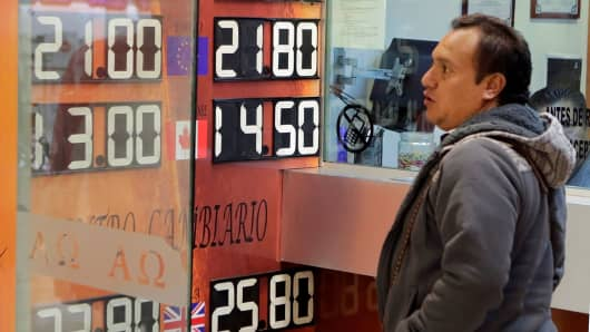 A board displaying the exchange rates of Mexican peso against the U.S. dollar and the euro is seen at a foreign exchange house at the international airport in Mexico City, Mexico November 8, 2016.